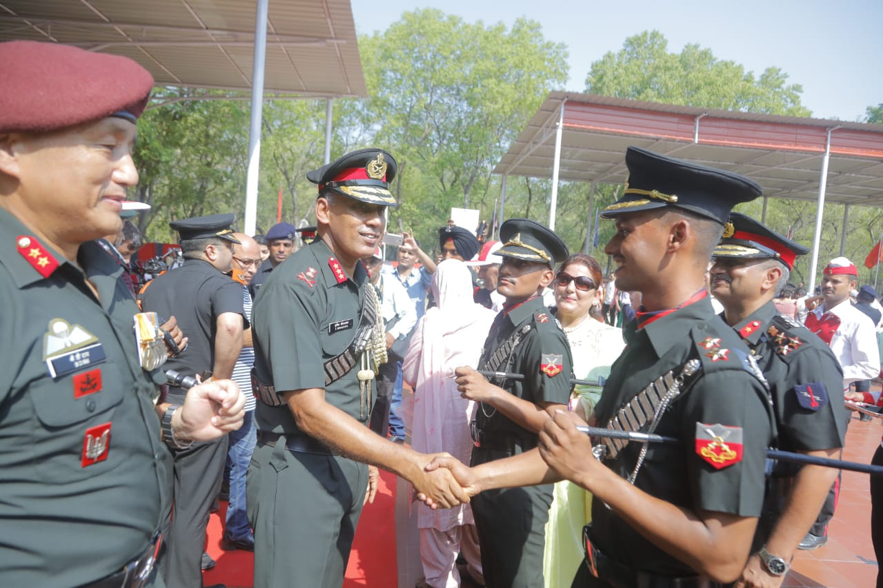 Commandant and Deputy Commandant & Chief Instructor, Officers' Training Academy Gaya congratulating newly commissioned officers after the Pipping Ceremony on 08 Jun 2019