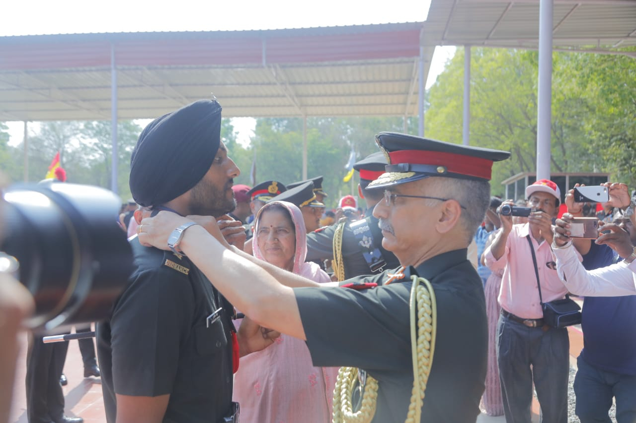 Lt Gen Manoj Mukund Narayana, PVSM, AVSM, SM, VSM, GOC-in-C, Eastern Command pipping a Gentlemen Cadet from Special Commissioned Officer's Course at OTA, Gaya on 08 Jun 2019