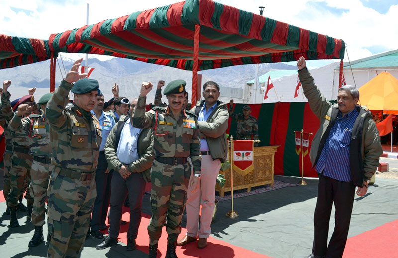 The Union Minister for Defence, Manohar Parrikar with the troops in Leh, during his visit to Siachen Glacier on May 22, 2015. The Chief of Army Staff, General Dalbir Singh is also seen.
