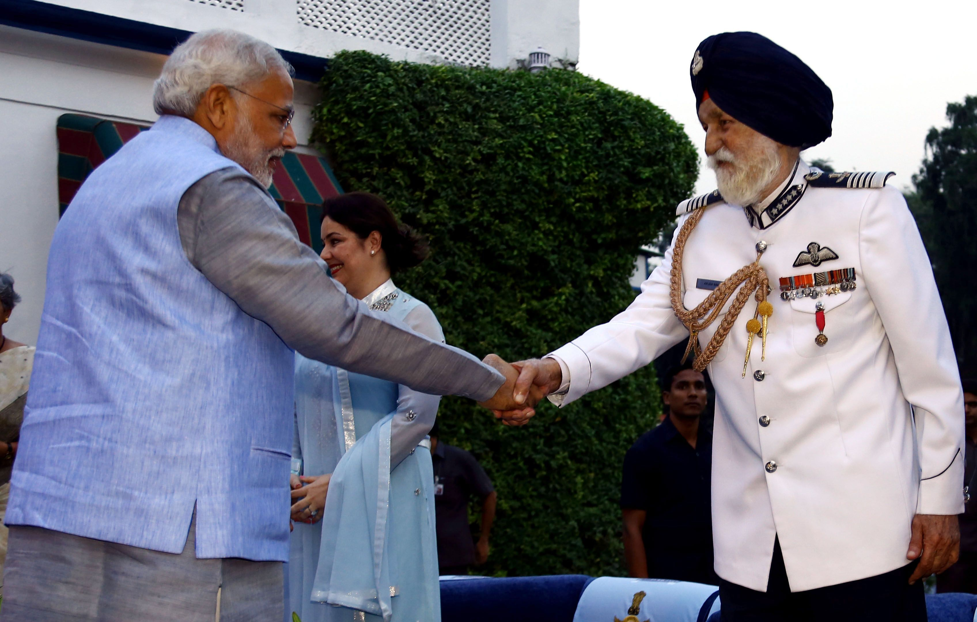 Prime Minister, Shri Narendra Modi meets the Marshal of the Air Force, Air Chief Marshal Arjan Singh during Air Force Day celebration at Air House on 08 Oct 14.