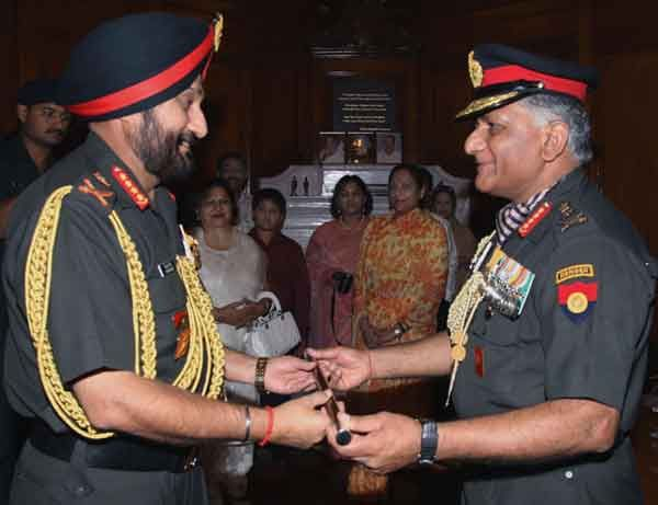 General Bikram Singh taking charge as the new Chief of the Army Staff from his predecessor Gen. V.K. Singh, in New Delhi on May 31, 2012.