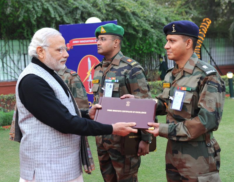 Prime Minister Narendra Modi presents certificates to innovators in the Indian Army