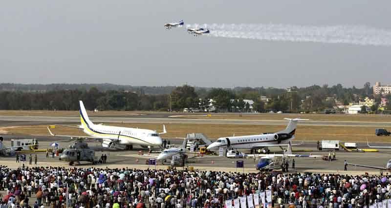 Spectators enjoying the Aero India 2013
